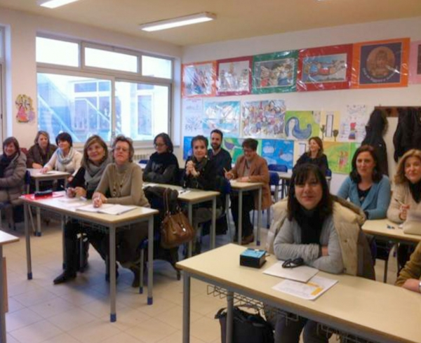 Acerra, Naples province, Teachers among the desks. Students climb into the chair.